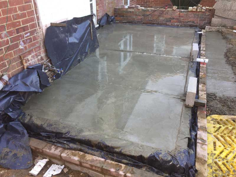 Oversite-preparation-for-a-house-extension,-poured-concrete.